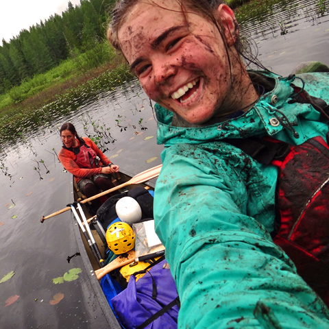 participant_canoeing-smiles_while_taking_selfie