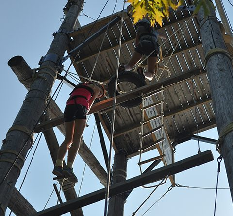 two-youth-climbing-high-ropes-structure