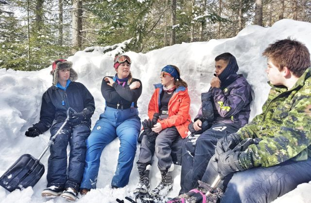 Kids-Sitting-in-snow-bank
